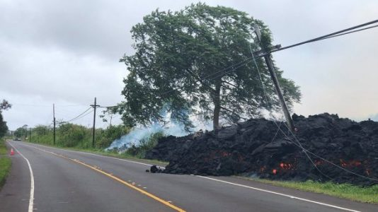 Hawaii volcano lava flow destroys over 70 homes, utility poles as it cuts off key highway