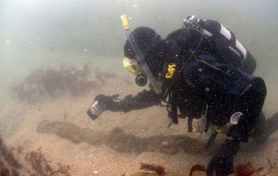 Divers discover 17th century anchors from 330-year-old remains of Britain's richest shipwreck
